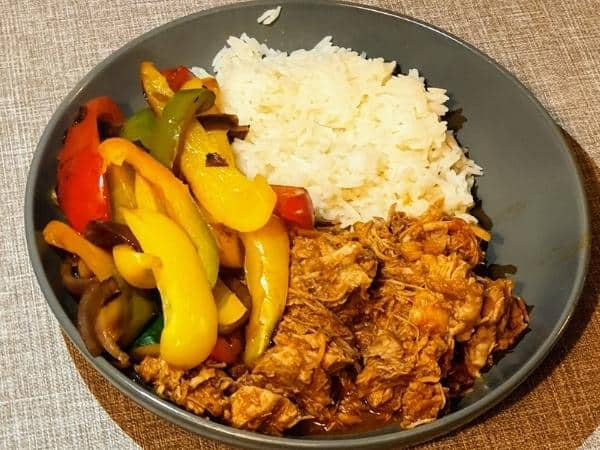 Bowl of fluffy rice, fried peppers and onions and Slimming World slow cooker bbq jackfruit